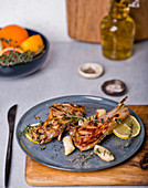 Grilled lamb chops with thyme and lemon slices