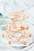 Easter biscuits on cake stand made from vintage crockery