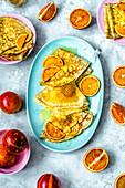 Custard pancakes on kefir with slices of red orange