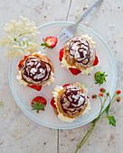 Chocolate puff pastry with strawberries and elderflowers