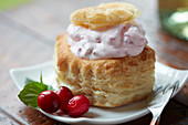 A vol-au-vent filled with cranberry and ricotta cream