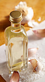 Homemade garlic vinegar with sea salt in a glass bottle
