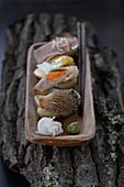 Potato nigiri with oyster mushrooms and fish