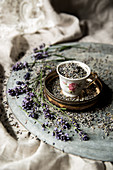Vintage teacup full of dried lavender