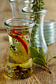 Homemade seasoning oil with garlic, chili, herbs of Provence and olive oil
