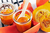 Homemade sweet pumpkin ketchup for barbecuing in jars