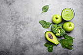 Ingredients for making green healthy smoothie with broccoli, apples, avocado and spinach