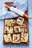 Sweet tarte cake with pears, almonds and raisins