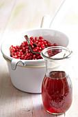 Homemade pomegranate essence with vanilla in a mason jar