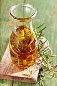 Homemade rosemary oil with dried tomatoes