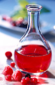 Homemade red berry vinegar in a glass bottle