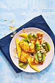 Fried semolina with kiwi and mango