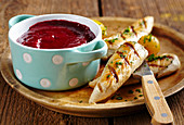 Homemade cherry ketchup served with grilled chicken strips