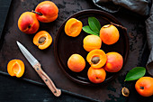 Fresh ripe apricots on brown rustic background
