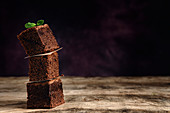 Chocolate brownie with mint on dark background