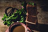Chocolate brownie with mint on dark background