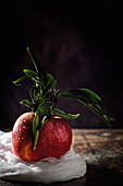 Raw red apple on dark table
