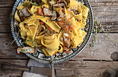 Plate with prepared pappardelle with pumpkin and boletus