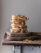 Heap of uncooked pappardelle on table