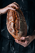 Man holding homemade rustic bread