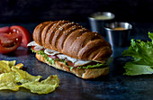 Big sandwich with vegetables and fried potatoes