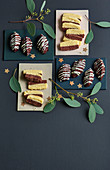 Juicy chocolate and coconut macaroons and black-and-white biscuits