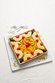 Square fruit tart with pistachio cream