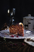 A piece of autumnal cranberry chocolate cake with nuts
