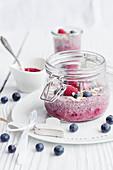 Raspberry chia pudding in glass jars