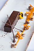 Mini chocolate cake with nuts and coulis (dessert)