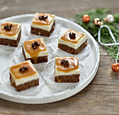Vegan cheesecake and gingerbread brownie cubes with caramel sauce