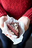 Beetroot cake garnished with chopped nuts and chocolate