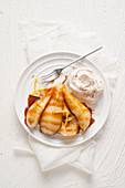 Pears with ginger and caramel and whipped cream