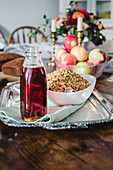 Rustic breakfast with cereals, maple syrup and apples