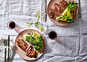Sirloin steaks with romaine lettuce and pistachios