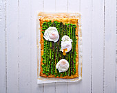 Asparagus and pea tart with poached eggs