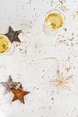 Two glasses of champagne and christmas decoration stars