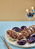 Nut, cranberry, rosemary and red cabbage stuffed beef fillet with roasted cabbage wedges