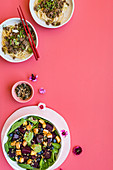 Spicy ostrich dan-dan noodles, blueberry-and-beetroot salad with crispy tofu and mixed seeds