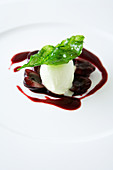 Cherries in port wine with basil ice cream