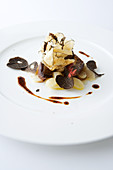 Pigeon with truffles on salsify