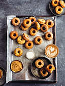Pumpkin donuts on a baking sheet