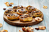 Poppy pastries with apple and cinnamon on a wooden board