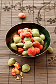 Wasabi peanuts in a small bowl (Asia)