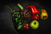 Mix of fresh vegetables on black background