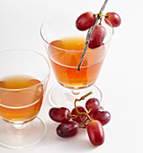 Glasses of homemade grape and vanilla liqueur