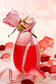 Homemade rose liqueur with fresh rose petals as a gift