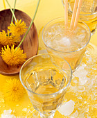 A glass of gomemade dandelion flower liqueur