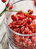 Candied rosehips in a glass