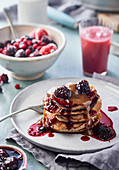 Banana pancakes with berries and caramel sauce